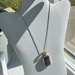 Silver necklace with purple pendant